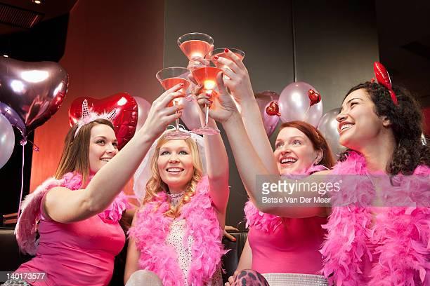 women toasting cocktails at hen night party. - addio al nubilato foto e immagini stock