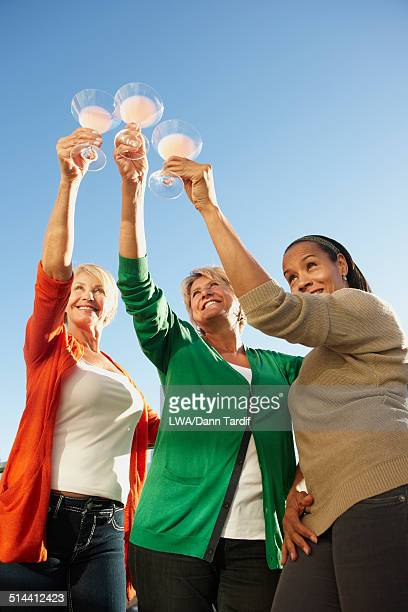 Women toasting each other outdoors