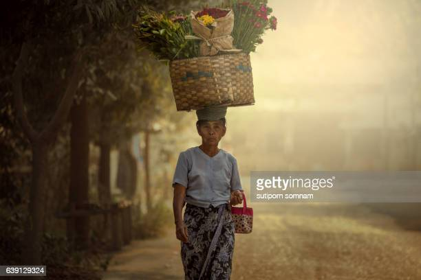 Women took flowers  put on the cart path to market