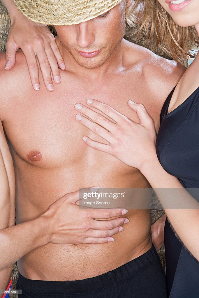 Woman touching mans chest