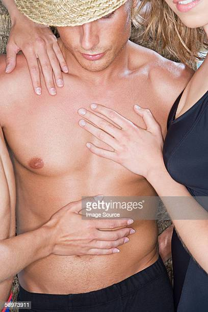 Women touching man's chest