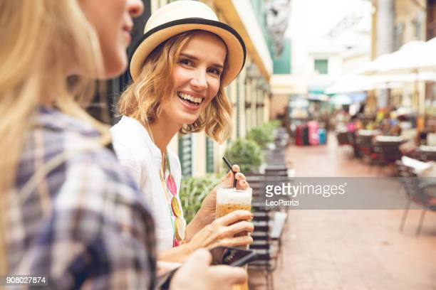 women tourist having a break in a cafe in thailand - iced coffee stock pictures, royalty-free photos & images