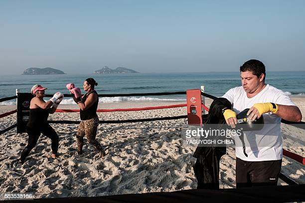 Women train inside a beach boxing ring at Pepe beach in Rio de Janeiro Brazil on July 26 2016 Since boxing trainer Moacyr Lima first installed a ring...