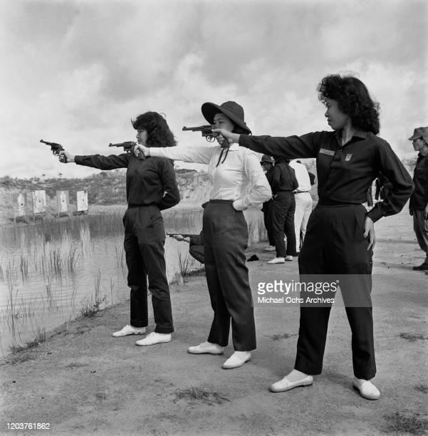 Women training on a firing range in Saigon , Vietnam, 1962.