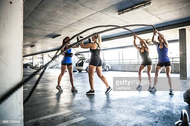 Women training on rope and boxing outdoor