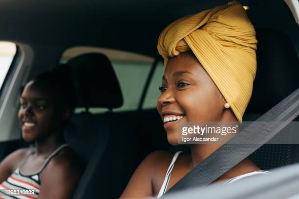 women traveling by car - turban stock pictures, royalty-free photos & images