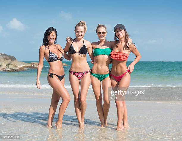 women traveling together, vacation by the ocean, spring break - hot babes stock photos and pictures