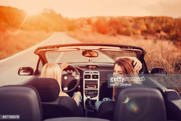 Women traveling with car