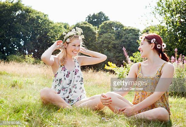 Women trying on daisy chains.