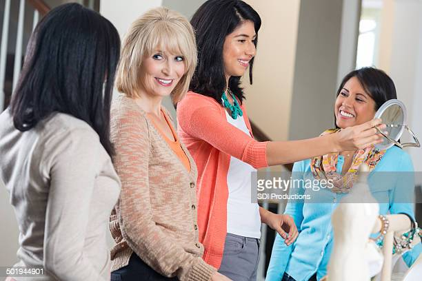 women trying on jewelry while shopping