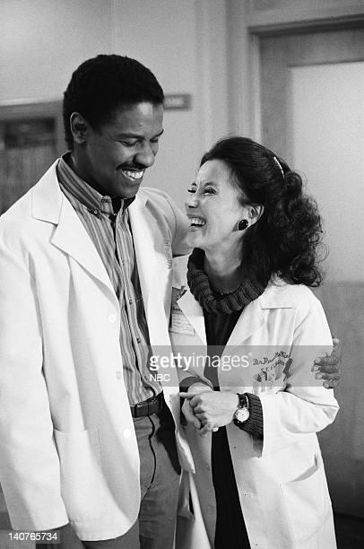 ST ELSEWHERE Women Unchained Episode 20 Pictured Denzel Washington as Dr Philip Chandler France Nuyen as Dr Paulette Kiem Photo by Ron Batzdorff/NBCU...