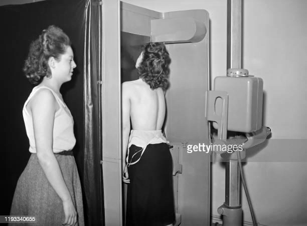 Women undergo an xray radiography of the lungs during a tuberculosis screening operation at a screening center rue d'Assas in Paris in November 1948