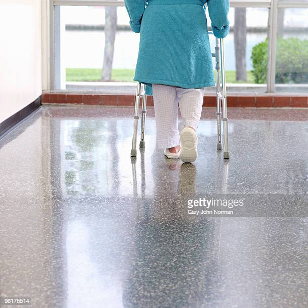 women use aid to help walk - norman elder stock photos and pictures