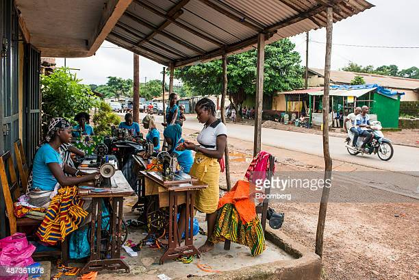 Women use sewing machines to manufacture new clothes in Conakry Guinea on Saturday Sept 5 2015 While Guinea produces bauxite which is refined into...