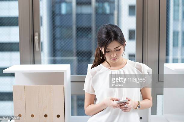 Women use their smartphones during the break