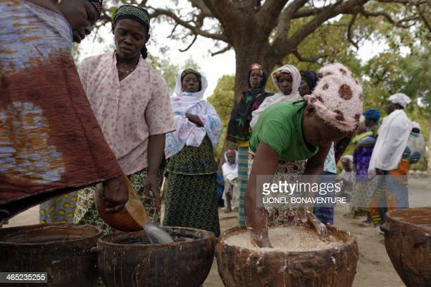 Women use traditional methods to make shea butter in Leo southcentral Burkina Faso on January 24 2014 French cosmetics company L'Occitane has been...