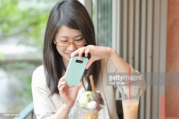 Women using a smartphone in cafe