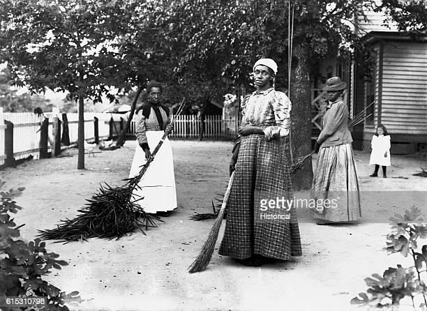 Women using brooms made of bambusa on Latimer's place Belton South Carolina September 29 1899 | Location Belton South Carolina USA