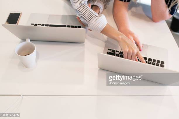women using laptop - doing a favor stock pictures, royalty-free photos & images
