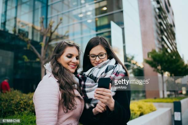 women using smart phone in budapest