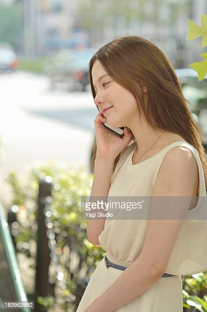 women using smartphone in the city of kyoto - sleeveless stock pictures, royalty-free photos & images