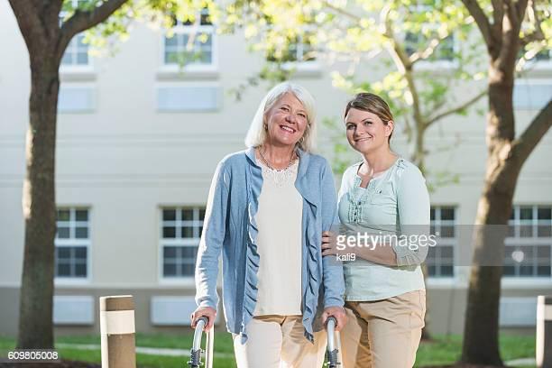 Women using walker, with adult daughter
