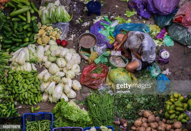 Women vendor selling fruits at the market in Ho Chi Minh City