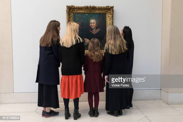 Women view Annie Swynnertons oil portrait of the suffragist Millicent Fawcett which is displayed at Tate Britain art gallery on 2nd February 2018 in...