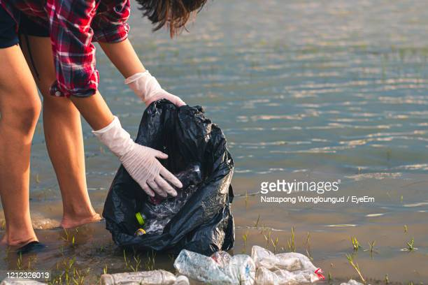 women volunteer help garbage collection for to recycling. - selfless stock pictures, royalty-free photos & images