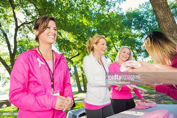 Women volunteering to raise money for breast cancer research