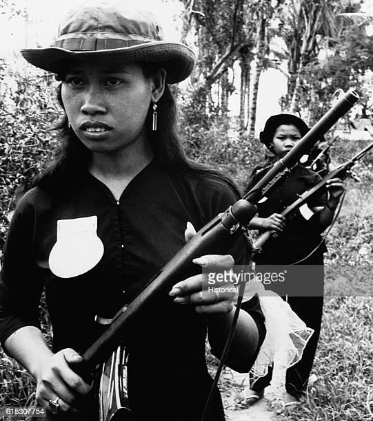 Women volunteers of the South Vietnamese People's SelfDefense Force patrol around the village of Kien Dien 50 kilometers north of Saigon to protect...