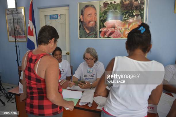 Women vote at a polling station in Santa Clara Cuba during an election to ratify a new National Assembly on March 11 2018 Cubans vote to ratify a new...
