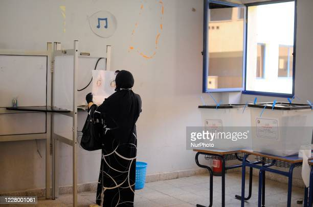 Women vote on the first day of the Senate elections inside a polling station in Cairo, Egypt, Tuesday, Aug. 11, 2020.