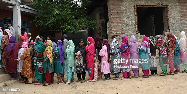 Women voters stand in queue outside a polling booth in Danter for By-elections for Anantnag assembly seat on June 22, 2016 in Anantnag, India. After...