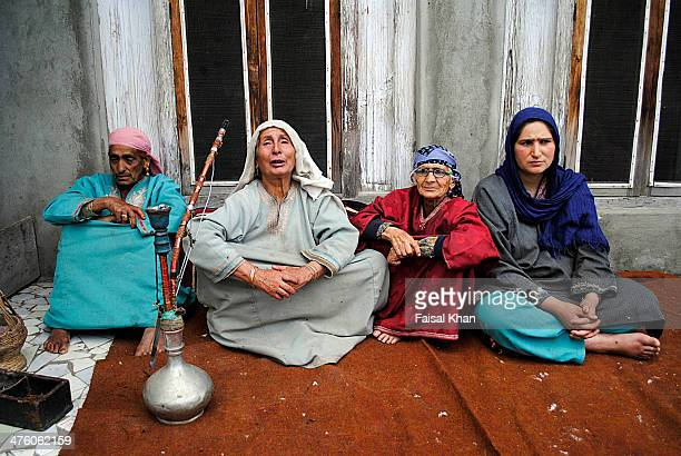 Women wail near the encounter site where two militants were killed in a fierce gun-battle with Indian army in Pulwama district of south Kashmir.