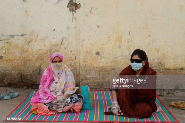 Women wait at a hospital for COVID-19 swab tests during the coronavirus crisis. Bangabandhu Sheikh Mujib Medical University is being used to conduct...