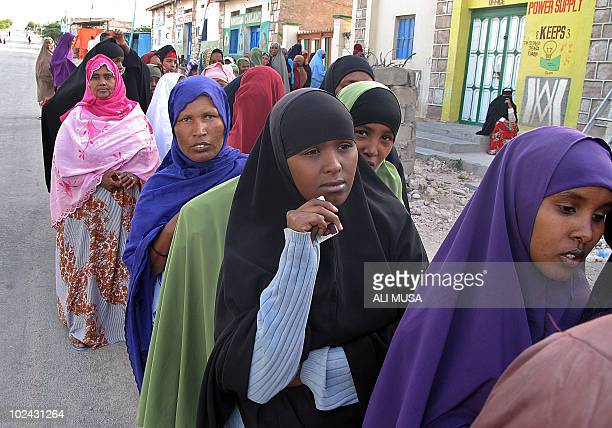 Women wait in line on June 26 2010 outside a polling station in Hargeisa the capital of the selfproclaimed state of Somaliland which closed its...