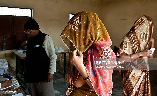 Women wait to cast their votes at a polling booth in Noida, Uttar Pradesh on February 28, 2012. The sixth phase of assembly polls will be held in...