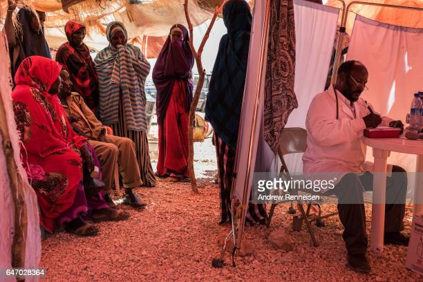 Women wait to see the doctor at a government run clinic at an IDP camp on February 24 2017 in Karin Sarmayo Somalia Brief rains brought an estimated...