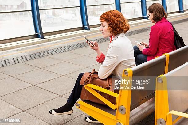 Women waiting for train on platform.