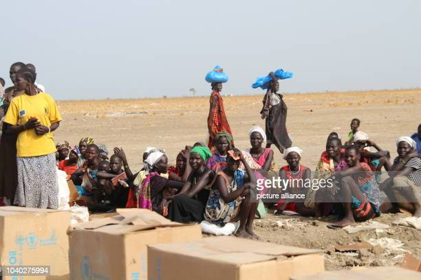 Women waiting in line to receive their monthly food aid ration by the Welthungerhilfe in Ganyliel, South Sudan, 24 March 2017. It is located in the...