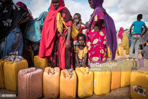 Women waiting to fill ferrycans with water at kiosk renowated by Polish Humanitarian Action Somalia in the grip of an unprecedent and devastating...