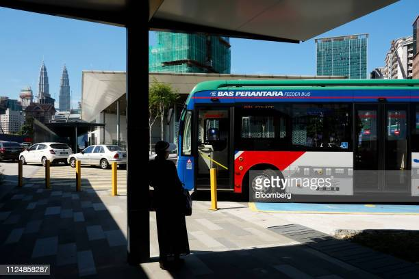 A women waits for the bus near the site of the under construction Exchange TRX precinct in Kuala Lumpur Malaysia on Tuesday Feb 12 2019 The project...