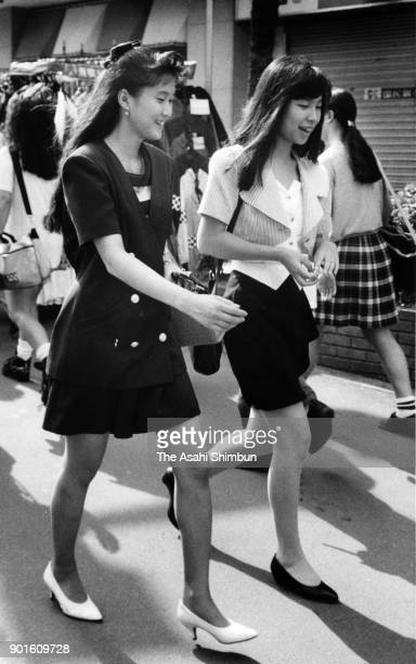 Women walk at a street on June 29 1991 in Tokyo Japan