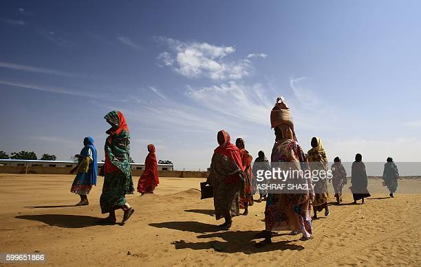 Women walk at the Abu Shouk camp for Internally Displaced People near North Darfur's state capital elFasher on September 6 2016 / AFP / ASHRAF SHAZLY