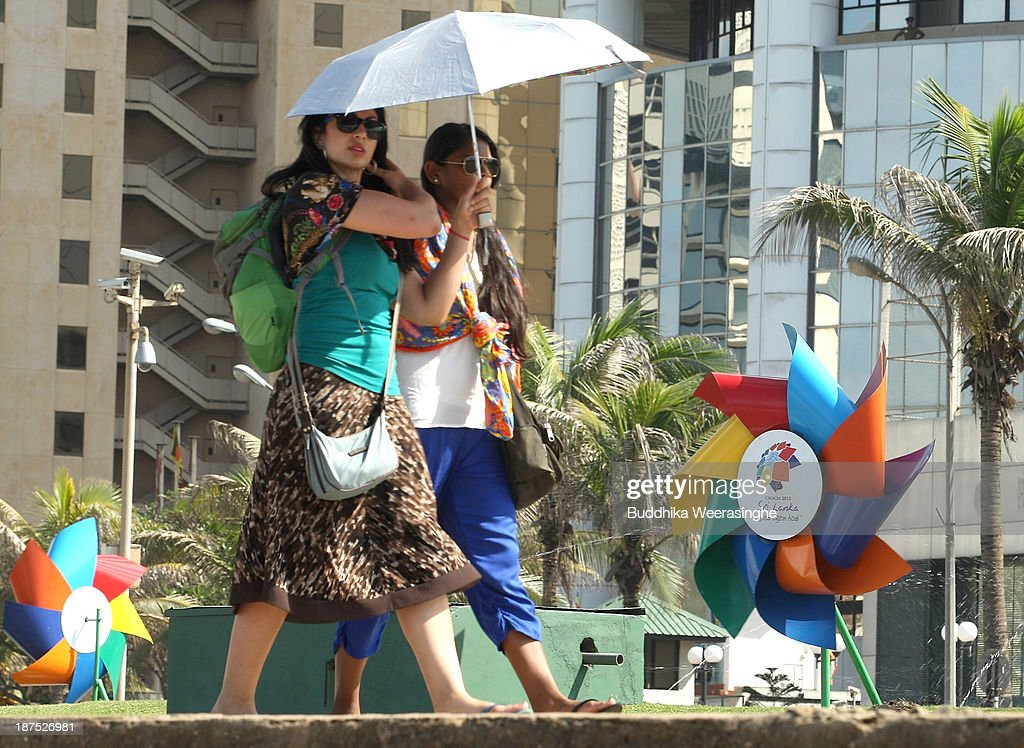 Women walk beside the decorations ahead of the Commonwealth Heads of Government (CHOGM) meetings on November 10, 2013 in Colombo, Sri Lanka. The bi-annual gathering of Commonwealth leaders will take place in the Sri Lankan captial, Columbo, November 15-17. CHOGM will move forward despite some human rights groups are urging leaders to boycott the meetings until Sri Lanka further investigates charges of war crimes. Canadian Prime Minister, Stephen Harper has already confirmed he will not attend.