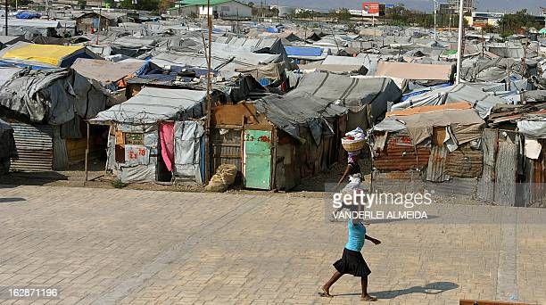 Women walk by a camp of survivors of the January 2010 quake in Haiti which killed 250000 people on February 28 2013 in PortauPrince The UN has in...