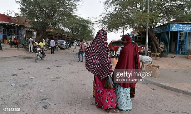 Women walk by a market of the central Niger city of Agadez on May 29 2015 AFP PHOTO / ISSOUF SANOGO