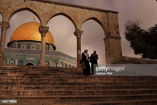 Women walk by the Dome of the Rock at the AlAqsa mosque compound in the Old City on December 01 2014 in Jerusalem Israel The Dome of the Rock is the...