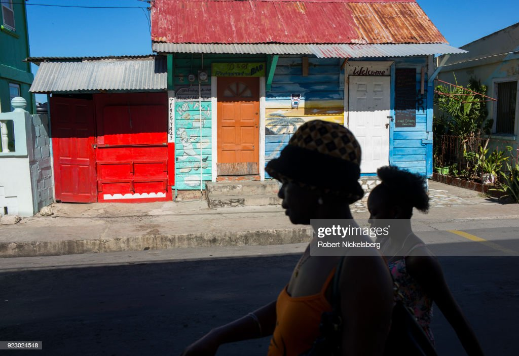 Women walk down the main market street February 3, 2018 in Hillsborough, Carriacou, Grenada. Carriacou is one of three islands that make up the country of Grenada.